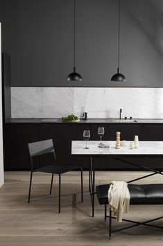 Dining area and kitchen with white marble Table and black studio pendants. Dining room inspiration and nordic minimalism. Furniture is Danish Design in a Nordic style. Wooden floor in kitchen area. Tile Top Tables, Round Marble Table, Piano Bench, Piano Room, Home Modern, Modern Living, Dining Room Inspiration, Furniture Inspiration, Scandinavian Living