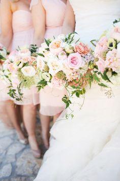 wedding bouquet - www.petalpushers.us photographer- www.eephotography.com loose garden mix with draping jasmine vine