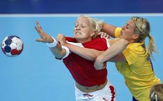 Women's Handball (Norway): Cat fight on the court featuring, Sweden's Johanna Ahlm, and Denmark's Rikke Skov. (Image Source: REUTERS/Marko Djurica) #London2012