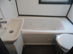 Jetted Tub - Barn Style by Upper Valley Tiny Homes