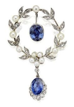 An Edwardian sapphire, pearl and diamond brooch, circa 1905. In the form or a wreath set with rose-cut diamonds and pearls, suspending an oval-cut sapphire swing drop and terminating in an oval-cut sapphire with a graduated rose and old round brilliant-cut diamond border. #HathawayTing #HathawayTing's Jewelry