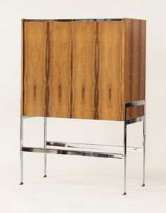 A rosewood and chrome cocktail cabinet, 1970's, possibly Merrow Associates Estimate £400-600