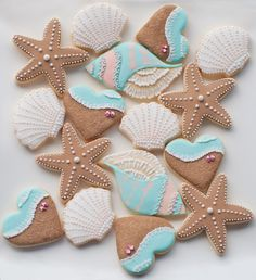 We've just finished making beach theme cookies as wedding favors. The wedding is going to be in Rarotonga and the couple requested a beach theme cookies. So we came up with some samples of what kind. Kinds Of Cookies, Cute Cookies, Cupcake Cookies, Cupcakes, Owl Cookies, Seashell Cookies, Mermaid Cookies, Wedding Cookies, Wedding Desserts
