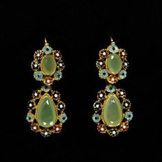 Pair of earrings, gold mesh and filigree, with enamelled decoration, set with chrysoprases, France, about 1825, Gold, in a variety of treatments, became a dominant element in jewellery from the 1820s. It was used successfully in mesh necklaces and bracelets, gold chain and wire work, also as a foil to gemstones.