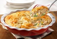 Cream of chicken soup, frozen veggies, chicken and a biscuit crust put the easy in this delectable chicken pot pie that bakes in only 30 minutes!  It's so tasty, it just might become your go-to recipe.