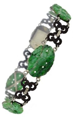 An Art Deco Carved Jadeite and Gold Bracelet, by Marsh & Company, circa 1930. Signed MARSH'S 18K.