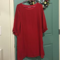Red Dress! A polyester dress with sheer overlay, only worn once! Bought at a boutique in Detroit and never wore it since! Very stylish and can be dressed up or down! Always Dresses Long Sleeve
