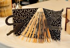Illusion: Craftswoman Rachel Ashe makes art by altering old books—she cuts, folds, paints, and glues objects onto the pages. You can view more of her work at Flickr.     (Photo © Rachel Ashe)    http://illusion.scene360.com/art/26461/cat-stuck-in-book-art/