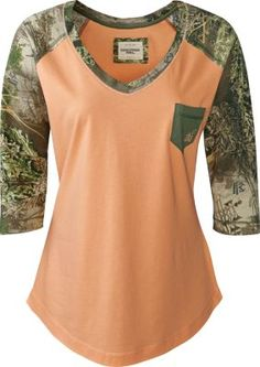 Realtree camo accents and a V-neck combine to make the Women's Realtree Girl Hallie Shirt perfect for the stylish outdoor lover. Raglan sleeves, contrast chest pocket and a rounded hem. 60/40 cotton/modal. Imported.  Colors:  Coral Sands, Heather Grey.  Sizes:  XS-XL.