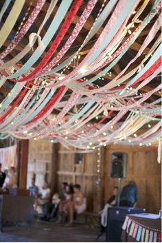 Use ribbons to create a faux circus tent affect on the ceiling. Hoola Hoop and a boat load of ribbon and you're on your way to The Big Top!