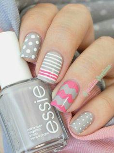 Grey pink and white nail polish with chevron stripes and polka dot nail art