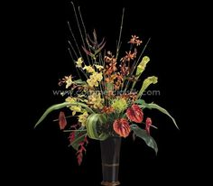 Tropical Heliconia and silk Anthurium flowers mingled with broad green leaves