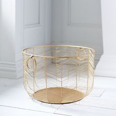 Our wrought iron basket, finished in a handsome golden hue, will make a wonderful addition to your kitchen. Generously sized, it's great for storage, but it's pretty enough to be a part of your tablescape.