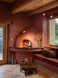 Beautiful Kiva Fireplace // inspired by pueblo architecture, was historically constructed of adobe in the corner of a room /// many designs on this site