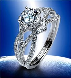 If it was a solid band instead of so many diamonds, I'd be happier. This would be a good alternate design, given he probably won't get me the ring I found yesterday... ;)