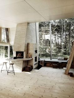 rad fireplace. what if one side faced the living room..and the other the kitchen and was a pizza oven?