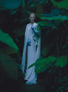 Tilda Swinton | W Magazine May 2013, photographed by Tim Walker on the Las Pozas Estate styled by Jacob K, Angels the Costumiers cape; Gucci gown; Vicki Beamon mask; Cornelia James gloves