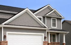 When it comes to choosing siding for your home exterior, it pays to consider fiber cement. Here are 7 benefits you'll love about fiber cement siding. Exterior Color Schemes, Exterior House Colors, Exterior Paint, Interior And Exterior, Colour Schemes, Vinyl Siding Installation, Siding Contractors, Outside House Colors, Exterior Solutions