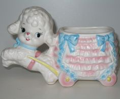 How adorable is this vintage baby nursery planter? Too sweet! Love the pretty bows and ruffles on the wagon, don't you?