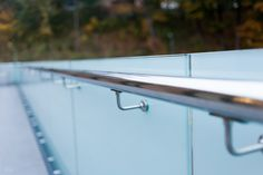 The frosted frameless glass balustrade features a floating stainless steel hand rail that is attached via small holes through the glass – Stock image Glass Balcony Railing, Frameless Glass Balustrade, Juliet Balcony, Stainless Steel Pipe, Laminated Glass, Privacy Glass, Safety Glass, Frosted Glass