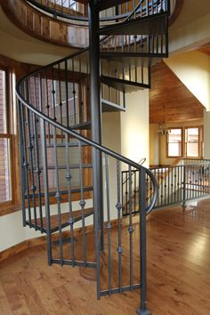 Stair Systems | wrought iron spiral staircase that leads to a loft overlooking the yard | Bayer Built Woodworks