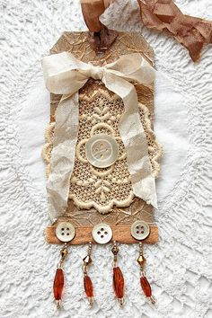 Tag - beads, button and bows.