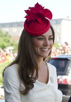 Kate Middleton got in the spirit of Canada day with a bright red fascinator featuring maple leaves.   Brand: Philip Treacy