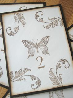 Rustic Woodland Wedding Table Numbers, Fall Table Numbers, Botanical, Bird, Butterfly, Daisy, Fern. $27.50, via Etsy.