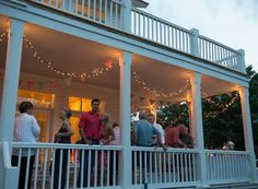 Strings of lights and yards of bunting add to the festive feel of a porch party at Gorham's Bluff
