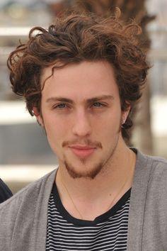 medium curly men's hairstyle
