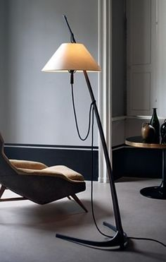 This freestanding luminaire from 1947 exemplifies Wiener Werkbund criteria. By threading the saber-shaped stand through the lamp shade, designers J. Kalmar and A. Pöll melded form as well as functi Wooden Floor Lamps, Adjustable Floor Lamp, Contemporary Floor Lamps, Contemporary Design, Unique Lamps, Glass Chandelier, Pendant Lighting, Decoration, Pantone