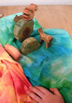 Telling stories with wood, rocks and scarves taps into imagination because of the simplicity of the items used.