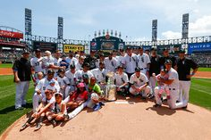 A few Blackhawks players and the White Sox pose with the Stanley Cup on June 21, 2015.