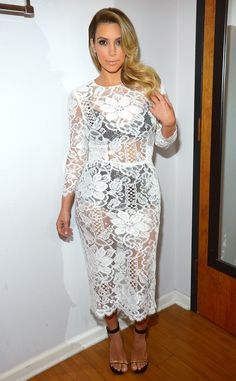 Kim Kardashian showing she still gots it.. in white lace with black after giving birth ..