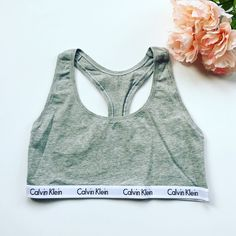 """CK Gray Bralette NWOT Calvin Klein gray bralette/sports bra. Smaller 1/2"""" logo band instead of 1"""" thicker band (also for sale in my closet). Super cute and soft! Celeb favorite. Will also bundle with CK panties in my closet for a discount  Reasonable offers can be made using offer button  Never washed or worn!  Condition: Brand new, never worn.  Trades  Please ask any questions prior to purchasing. All sales final. Calvin Klein Intimates & Sleepwear Bras"""
