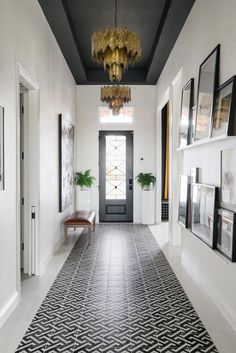 Grey tray ceiling with black and white inset tile runner. Tour HGTV Smart Home 2 - Smart House - Ideas of Smart House - Grey tray ceiling with black and white inset tile runner. Tour HGTV Smart Home 2019 Dark Ceiling, Colored Ceiling, Paint Ceiling, Hallway Ceiling, Hallways, Painted Tray Ceilings, Ceiling Color, Ceiling Painting, Hallway Wall Decor