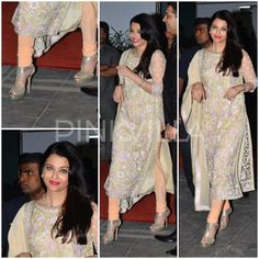 Aishwarya Rai Bachchan was snapped last night at a wedding reception. The actress looked super pretty in a pastel colored floral embroidered Abu Jani - Sandeep Khosla suit. Simple hair, a diamond necklace, red lips and glitter heels rounded her look out. Aishwarya Rai Photo, Actress Aishwarya Rai, Aishwarya Rai Bachchan, Designer Gowns, Indian Designer Wear, Indian Attire, Indian Wear, Indian Dresses, Indian Outfits