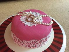 Pearls and lace themed cake