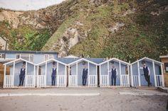 Beach huts, Blue beach wedding, groom, beach groom, wedding beach, blue suits, beach wedding, Cornwall wedding, Lusty Glaze Wedding,