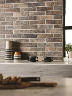 These brick slips by Original Style feel and look exactly like traditional bricks and can be used on both walls and floors. Use Antico Casale Mattone or Fumo to underline that rustic look everyone is after Modern Kitchen Tiles, Kitchen Wall Tiles, Industrial Style Kitchen, Farmhouse Style Kitchen, Farmhouse Pottery, Splashback Tiles, Tile Manufacturers, Brick Tiles, Tiles Texture