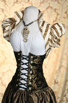 this is the bolero I will make for my steampunk costume. this is the bolero I will make for my steampunk costume. Viktorianischer Steampunk, Steampunk Cosplay, Steampunk Clothing, Steampunk Fashion, Victorian Fashion, Steampunk Corset, Victorian Corset, Gold Corset, White Corset