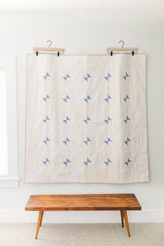 A modern take on a classic Amish quilt design, this minimal throw-size quilt features cornflower blue triangles, arranged in a pretty and graphic pattern. As part of Salty Oat�s mission to support Ame