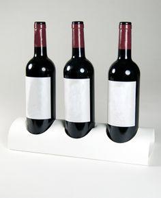 Soporte expositor de 3 botellas realizado en Forex