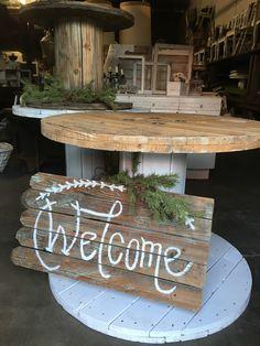 Spool Tables   vintageowlrentals.com Barn wood signage.