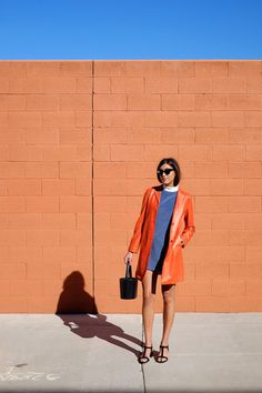 Not too much of a fan on the collar on this dress however I do love everything else. I always love how beautiful a bright orange looks with a bright blue, paired with classic shades and a cute, sleek hair style and you are good to go