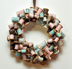 Spools, scrap material and twine wreath and hot glue