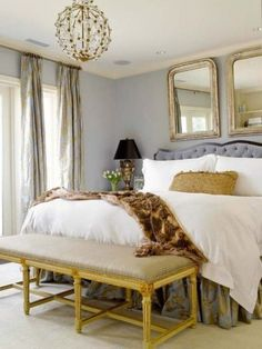 Gold and gray bedroom, luxurious fabrics, double mirrors over bed