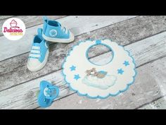 Bib, Dummy and Converse Shoes out of fondant for a Christening Cake l Delicious Sparkly Cakes Pokemon Go Cakes, Polymer Clay Elephant, Fondant Baby Shoes, Baby Bib Tutorial, Sparkly Cake, Biscuit, Baby Boy Cookies, Sugar Art, Handbag Cakes