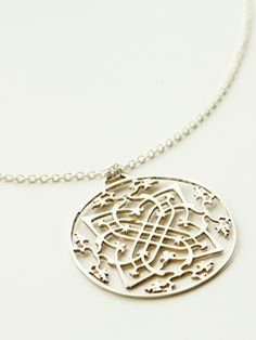 "Laser cut Sterling Silver medallion (approx 1.75"" diameter, chain measures 27"") on a 27"" chain"
