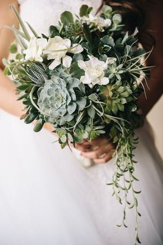 Succulent bridal bouquet | Wedding Flowers: Gorgeous Full Cascading Bridal Bouquets via @insideweddings